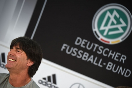 Germany's head coach Joachim Loew smiles during a press conference on the sideline of the team's preparation for the upcoming Euro 2016 European football championships, on May 31, 2016 in Ascona. / AFP PHOTO / PATRIK STOLLARZ